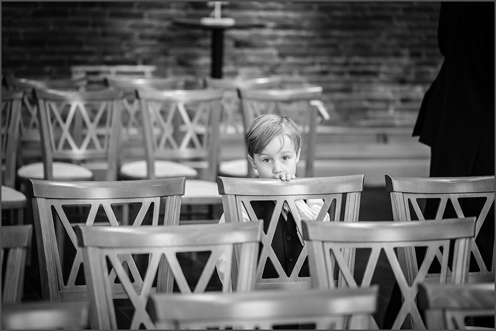 cute page boy at mythe barn warwickshire in the ceremony room